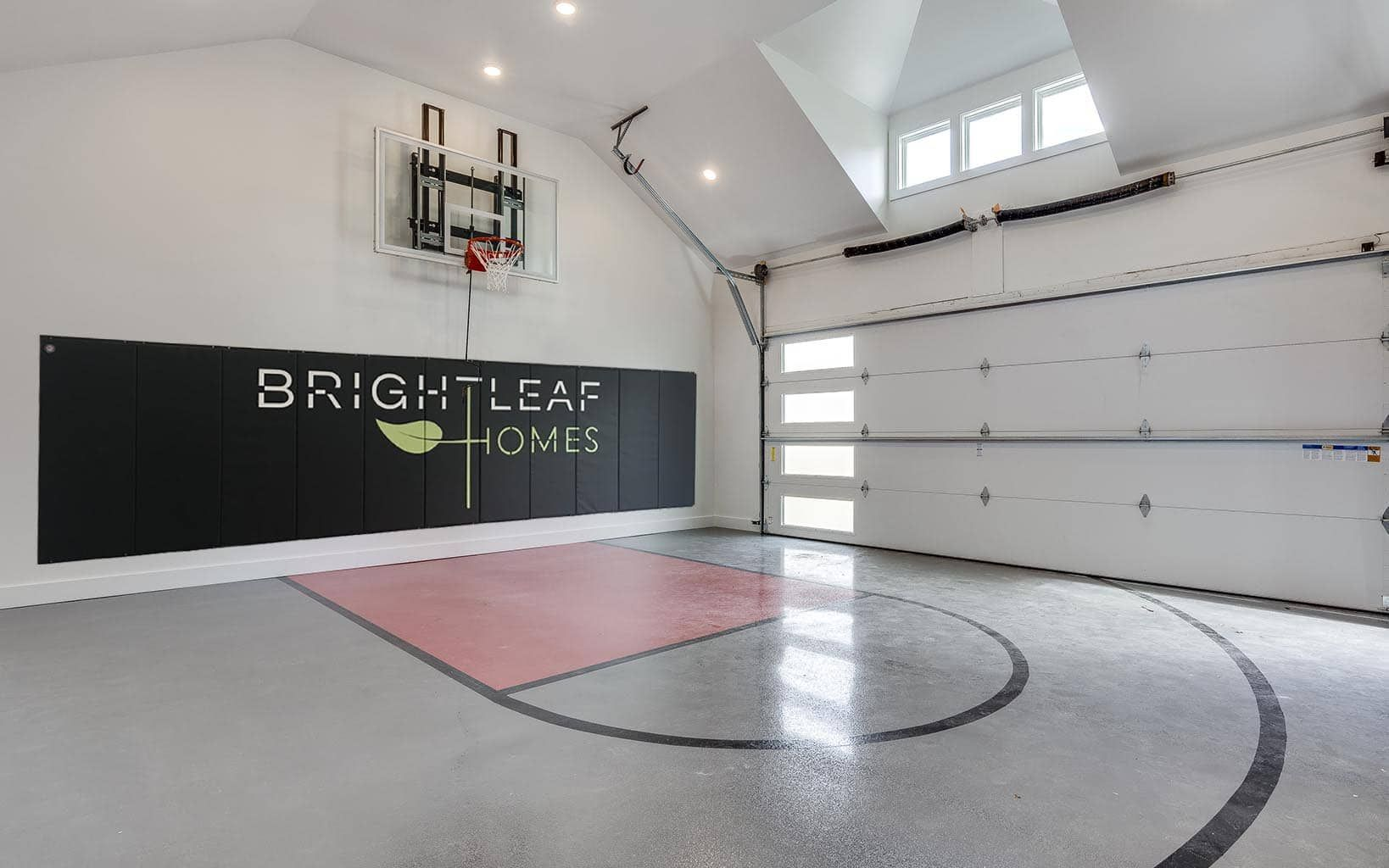 Is There Anything Cooler Than An Indoor Basketball Court This Detached Garage Was Fini Home Basketball Court Indoor Basketball Court Basketball Court Flooring