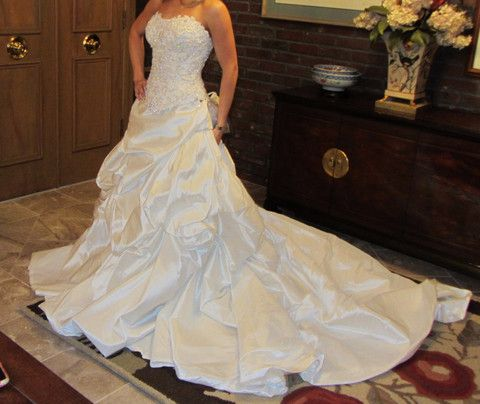 Never been used or altered. Two piece wedding gown. Original tags ...