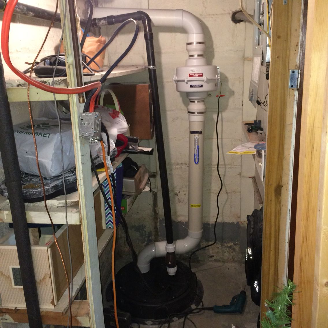 Radon Mitigation System In Basement Closet.