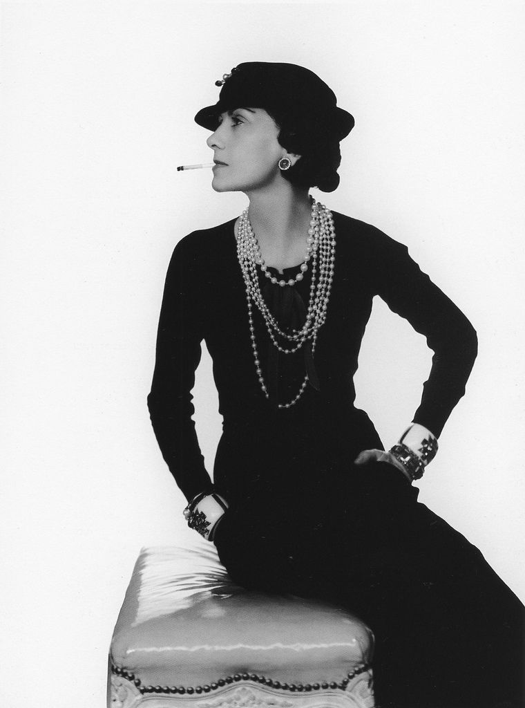 The timeless style of Coco Chanel in her little black dress adorned with strands pearls of various lengths and her favorite Verdura cuffs, photo by Man Ray, 1935
