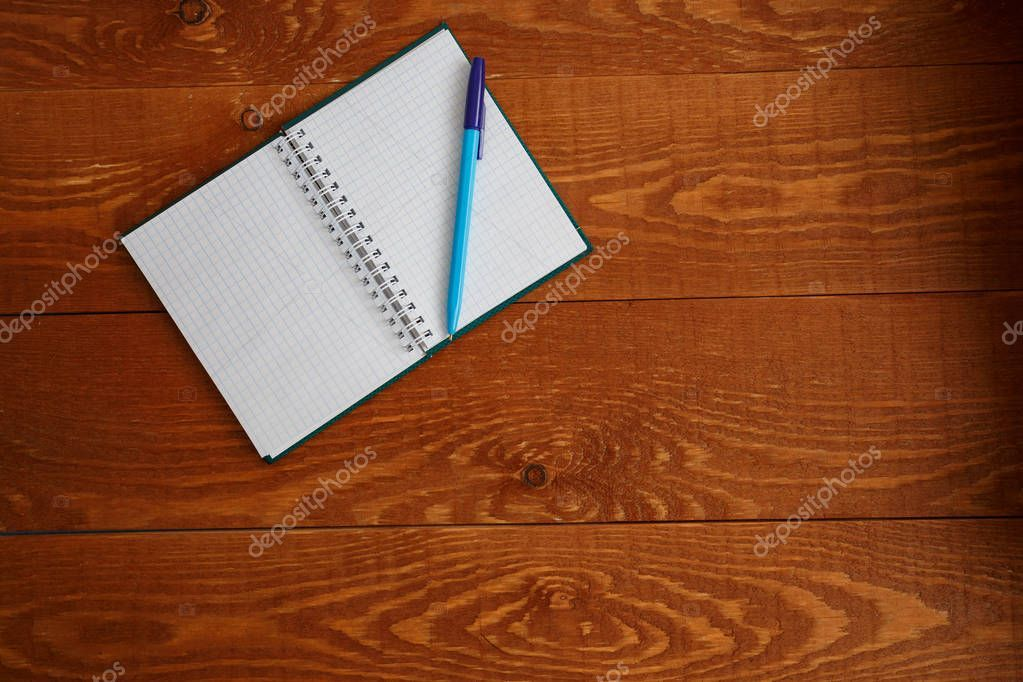 Blank Notebook And Pen On Wooden Desk Top View Stock Photo