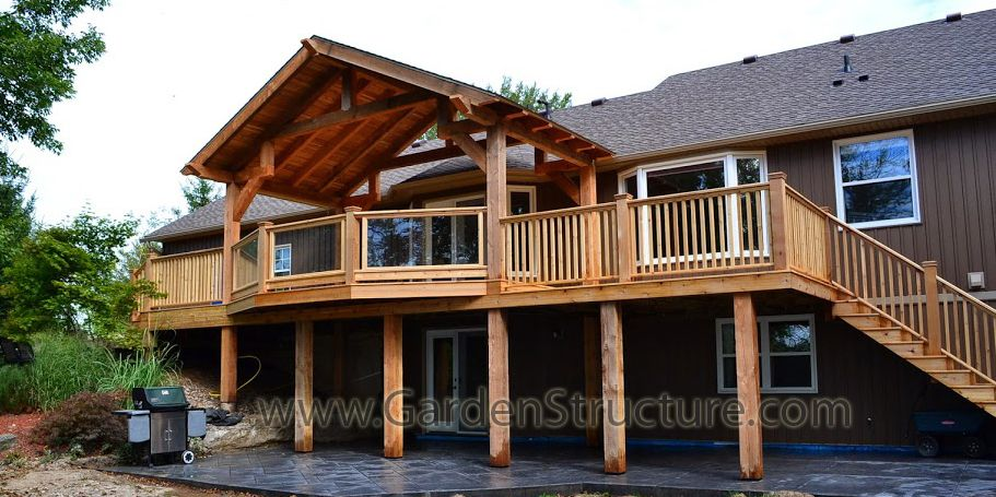 A large deck with pitched timber framed roof structure on top hamilton ontario patio design - Houses large patios ...