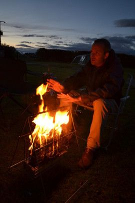 Flamin' brilliant ! A portable folding campfire just for fire logs. No mess, no fuss, no marks. Just safe, cosy and warm nights around the campfire – perfect !