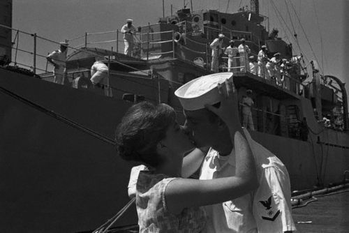 A sailor from the USS Keller, which has just docked at the Navy Yard in Washington, DC, greets his wife with a kiss. The ship has arrived in Washington for a short port of call.