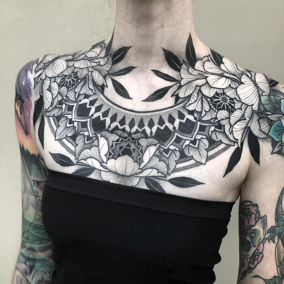 An incredible black and grey floral Mandala tattoo by