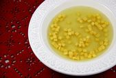Photo of Golden broth and small parmesan cubes / Golden broth and p ….