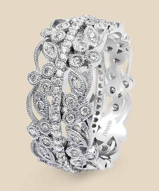 A delicate eternity band of diamonds is further defined by intricate diamond vines and leaves accented with fine milgrain detail creating a bold yet romantic design. Diamond info:  120-RD 0.95 CTS