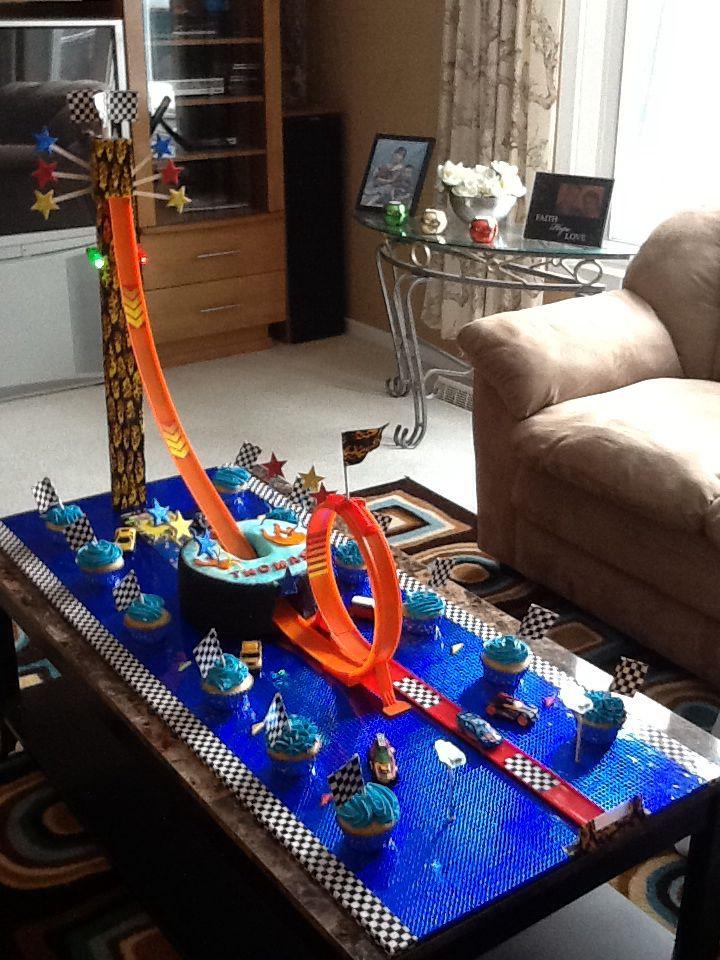 Racing car cake...yes it goes thru the cake :) cjcakecreations.com