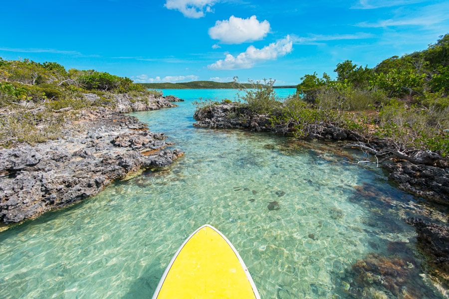 Stand up paddle boarding at Chalk Sound, Providenciales, Turks and Caicos Islands.