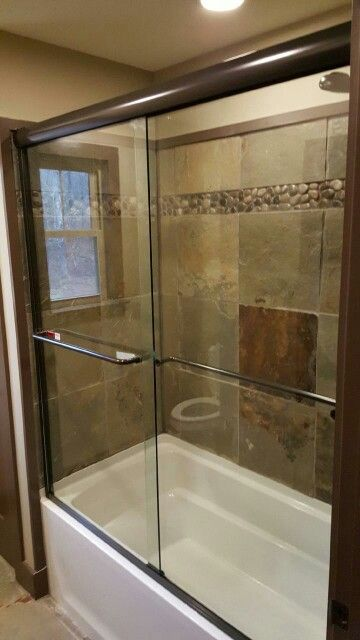 Nothing Better Than A Nice Set Of Double Sliding Doors On A Tub - Asheville bathroom remodeling