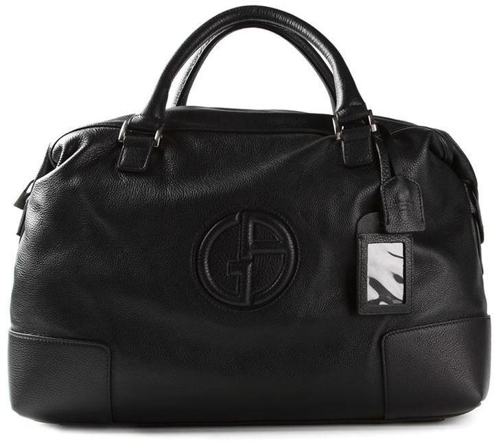 €1,095, Bolsa de Viaje de Cuero Negra de Giorgio Armani. De farfetch.com. Detalles: https://lookastic.com/men/shop_items/81340/redirect