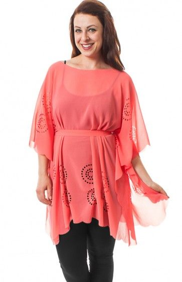 77953e2a0a3 Boat neck 1 2 wide sleeve sheer poncho top featuring circular holed design  detail