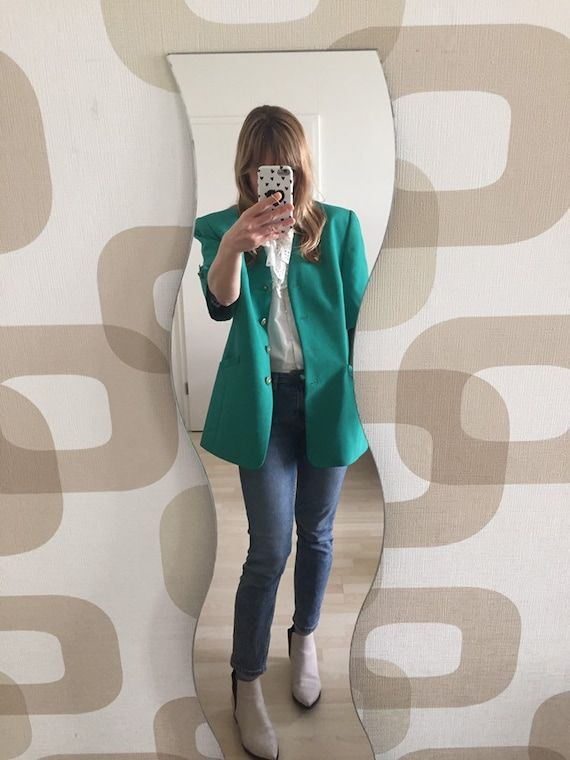"""Fabulous Kelly green wool blend blazer with gold crest button detailing. Love the fit, very 80's Boss lady fabulous. Blazer is fully lined & in perfect condition, excellent quality. Please note the colour in the photos appears a little more teal/aqua & the actual shade of green is that colour of green that is EVERYWHERE in fashion right now. Label is Marcona, Design Exclusiv. Thank you & Bye! Length- 32""""Shoulders- 18""""Sleeves- 13""""Bust- up to 44""""Waist- up to 42""""Hips- up to 45"""""""