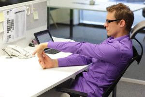 7 yoga poses you can do at your work desk to relieve