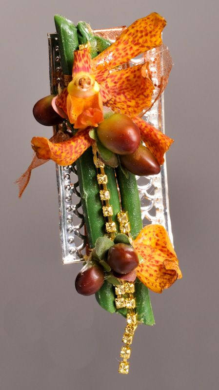 From the Fall Harvest Collection - Love this boutonniere on the Romanesque Boutonniere Holder, accented with Champagne Dazzleline, all from Fitz Design, available at: www.pioneerwholesaleco.com. Design by Tom Bowling, AIFD, PFCI.