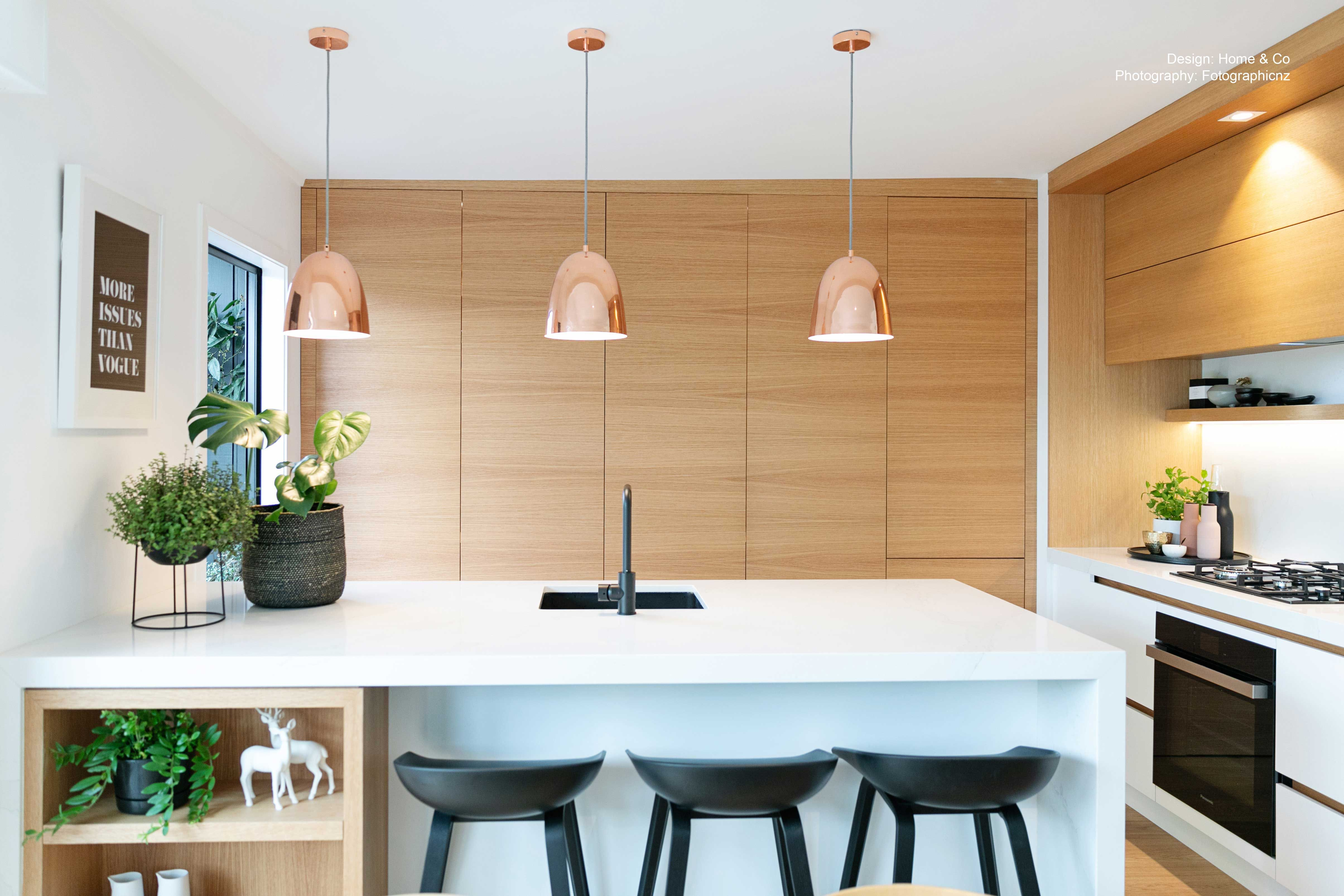 Blonde wood cabinets work together with white, rose gold ...