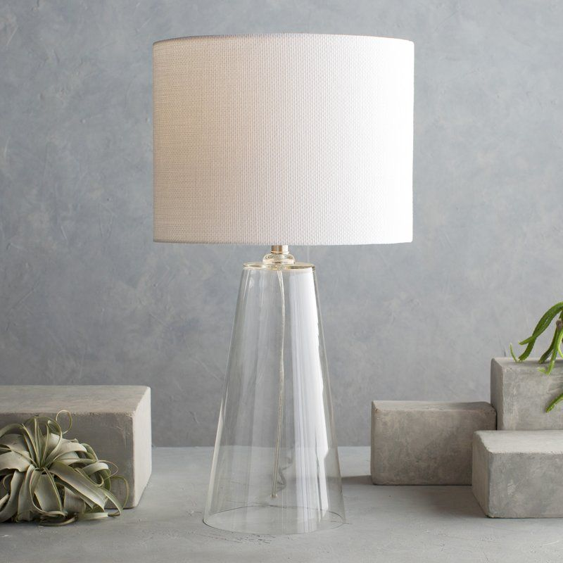 Pairing A Clear Glass Base With A Classic White Drum Shade This Chic Lamp Lends A Touch Of Elegance To Any Lamps Living Room Room Lamp Clear Glass Table Lamp