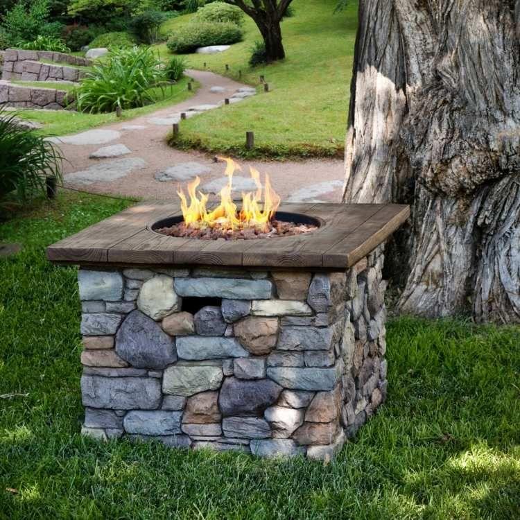 feuerstelle-garten-bauen-gas-bruchsteine-holz-dielen-ablageflache, Garten und bauen