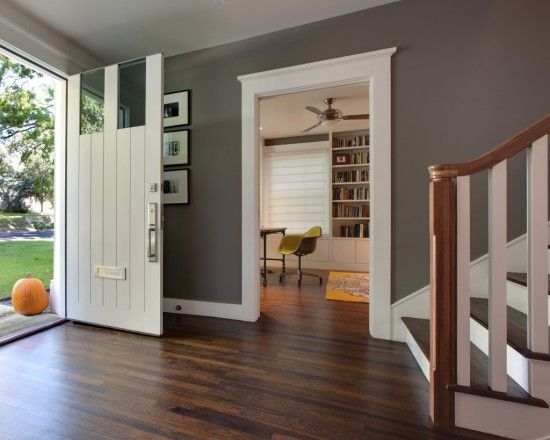 Warm Country Home Is Made Modern With Clean Door Casing Neutral Wall Color And Refinished Wood Floors The Original Character Is Retaine Home House Grey Walls