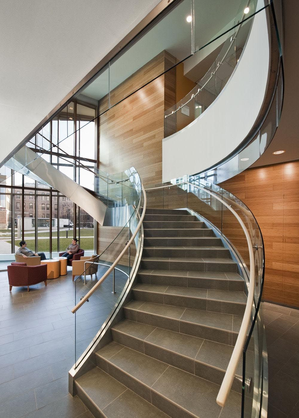 Sustainable business school design in boston united for Curved staircase design plans