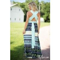 """Our amazingly versatile, super soft and comfortable maxi dress can be worn a multitude of ways. Themint halter top is lined and the stretchy deep navy skirt in a fun chevron pattern in neon lime green and white is unlined and hemmed. Check out our Filly Flair Boutique YouTube channel video """"How To Wear A Convertible Maxi Dress: 24 Amazing Ways!"""" Resting Elastic Bodice in Small 20"""" Medium 22"""" Large 24""""Bodice Length in Small 43"""" Medium 44"""" Large 45""""Halter Ties Length in Small 78"""" Medium 7..."""