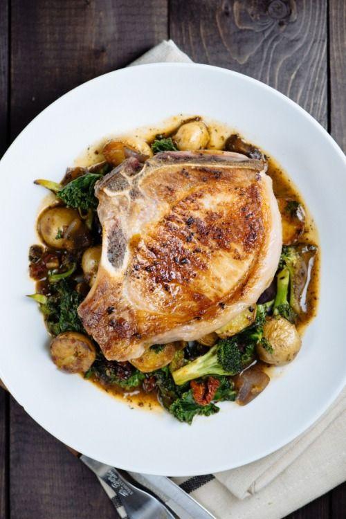 Pan Roasted Pork Chop on Potato, Kale, and Broccoli with Pan…