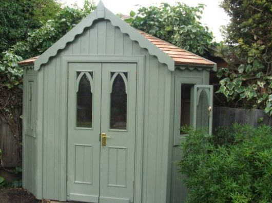 Corner shed like the gothic arch windows casette for Corner garden shed designs