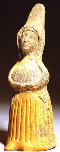 La Serreta, Valencia, Spain, where this figure was found, is also a coastal community. This female has clasped hands over her stomach and under her breasts. Circa 200 BCE.