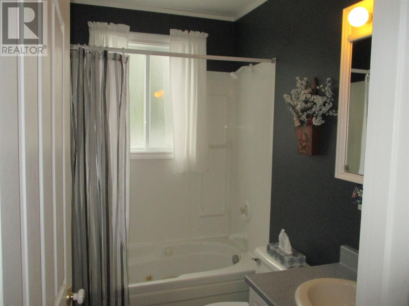 bathroom with tub surround