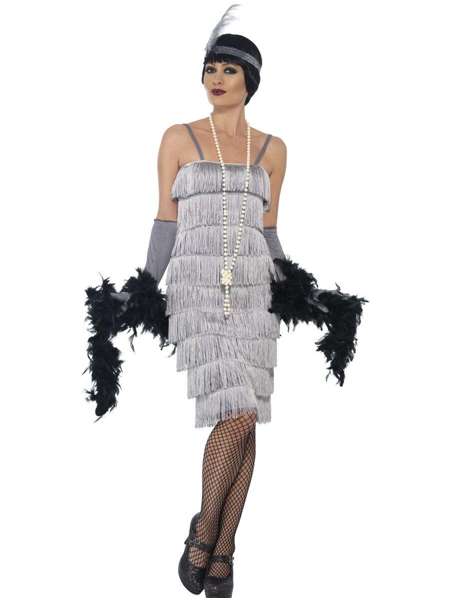 Flappertytöön mekko; hopea. Mekkoasun rimpsuhelma peittää