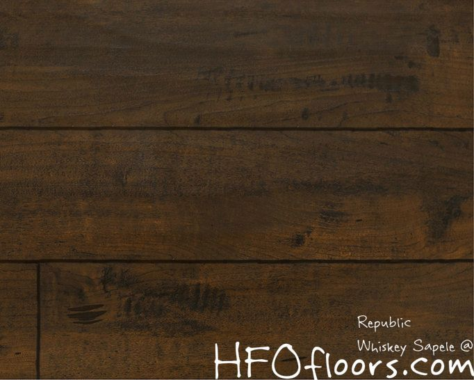Frontier Collection Whiskey Sapele 12.3mm laminate. Available at HFOfloors.com.
