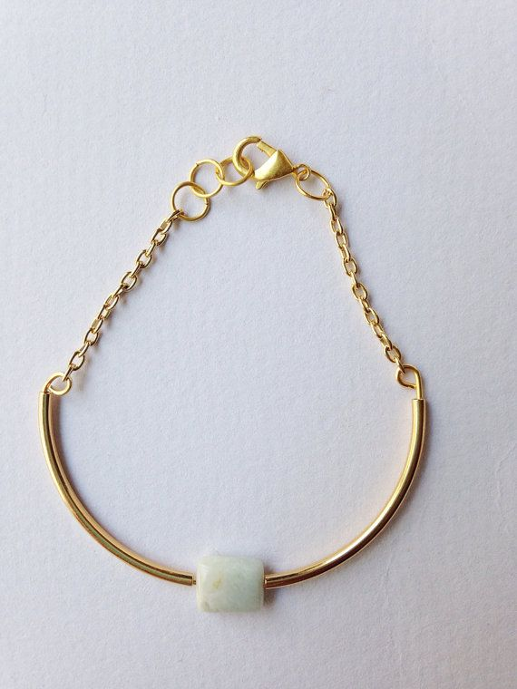Gold tube bracelet with a single stone accent  on Etsy, $18.00