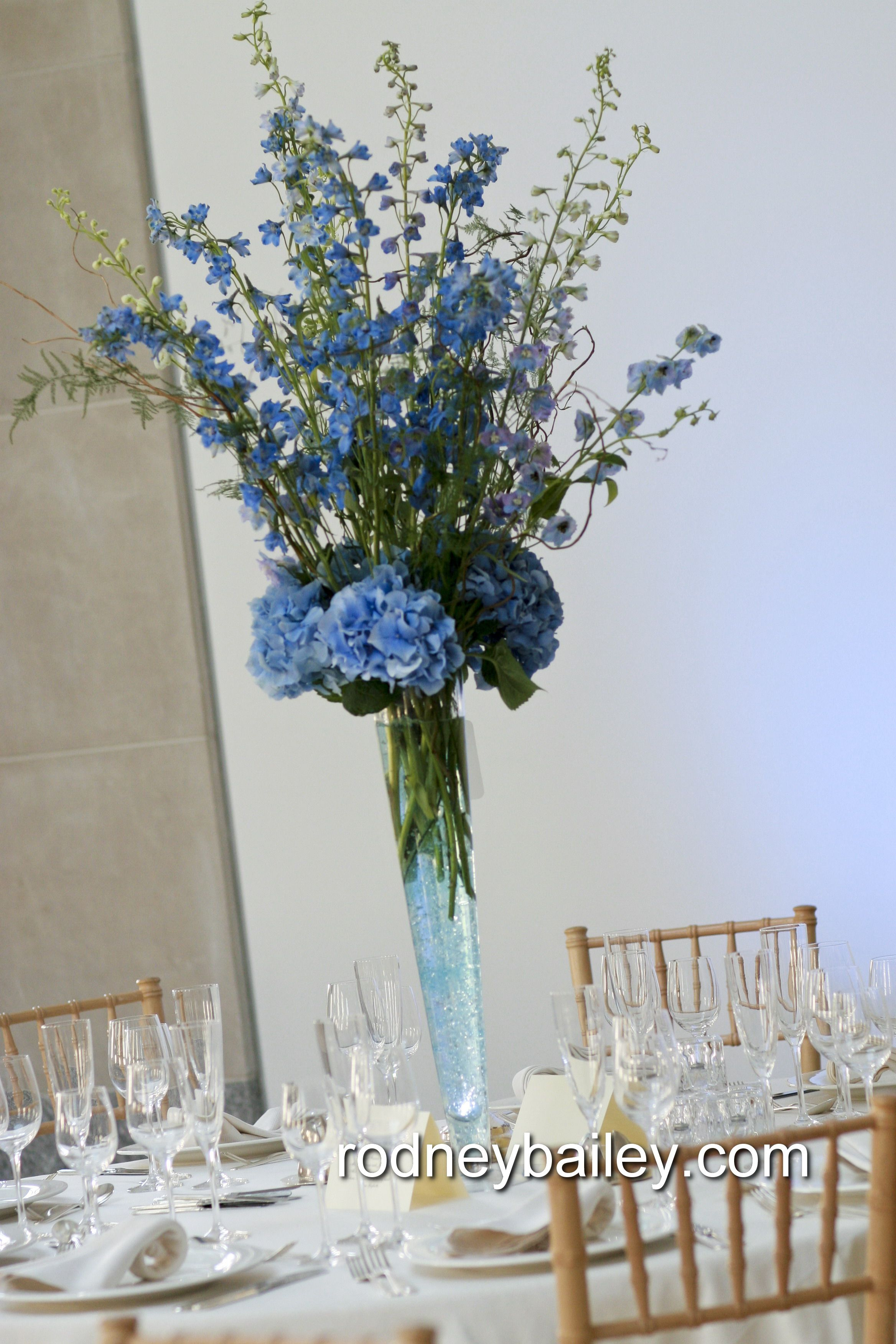 Tall centerpiece design of blue delphinium and hydrangea