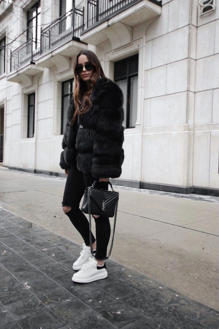 Black fur outfit and Alexander McQueen sneakers Valentino