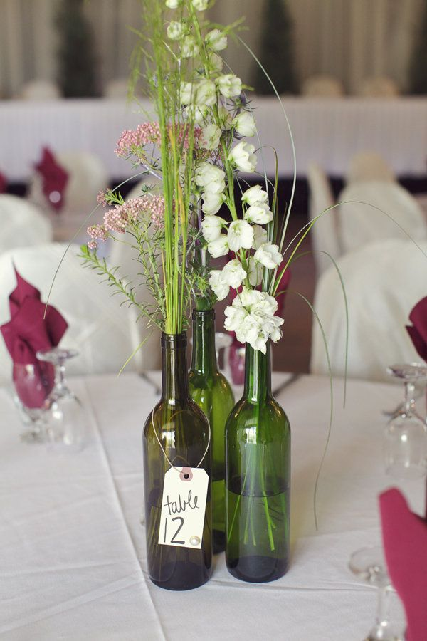 British columbia wedding by cassie 39 s camera bottle for Wedding table decorations with wine bottles