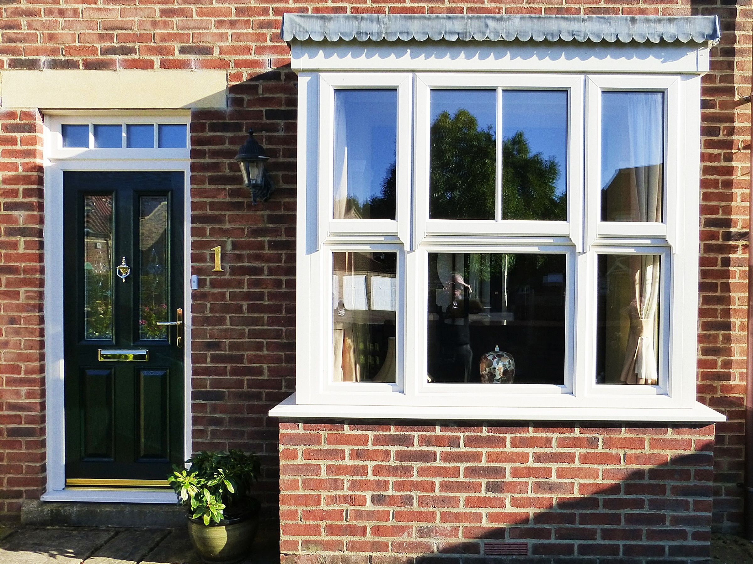 Stunning box bay windows with high quality rehau upvc for Upvc window designs