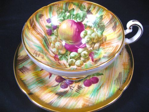 OLD ROYAL FRUIT MULTI COLOURED BACKGROUND TEA CUP AND SAUCER