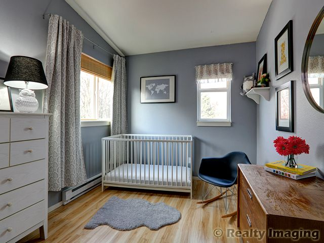 Soft greys and warm woods in the nursery of our SE Portland listing!