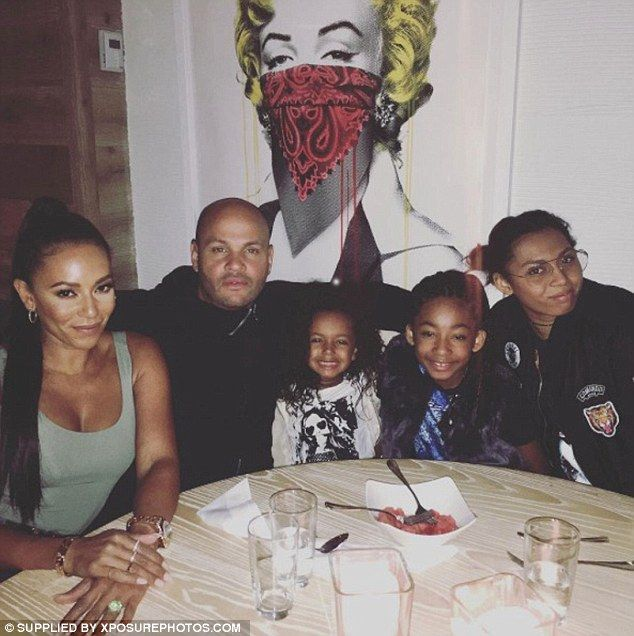 Family time: Mel B and Stephen want to make sure their children are 'ok' according to the website