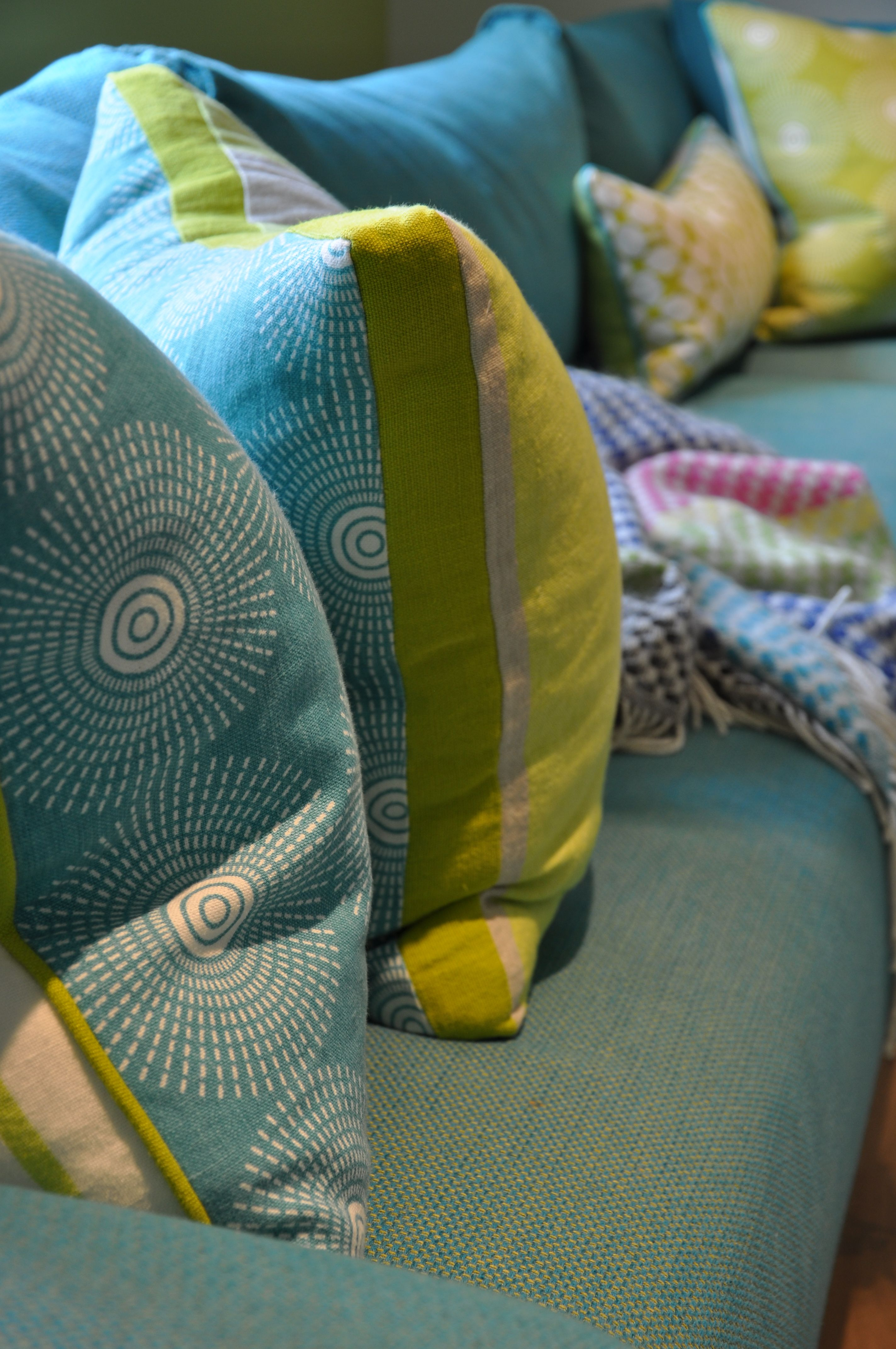 Colourful and vibrant scatter cushions and throws perfect for a