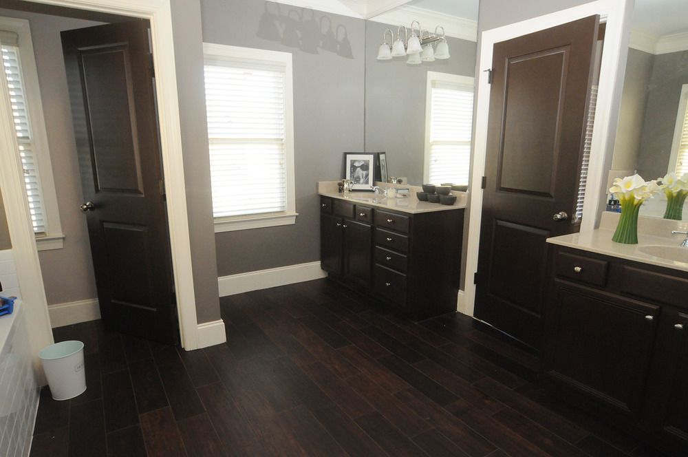 20 Beautiful Master Bathrooms With Wood Floors Wood Floor Bathroom Hardwood Floors In Bathroom Hardwood Floors Dark