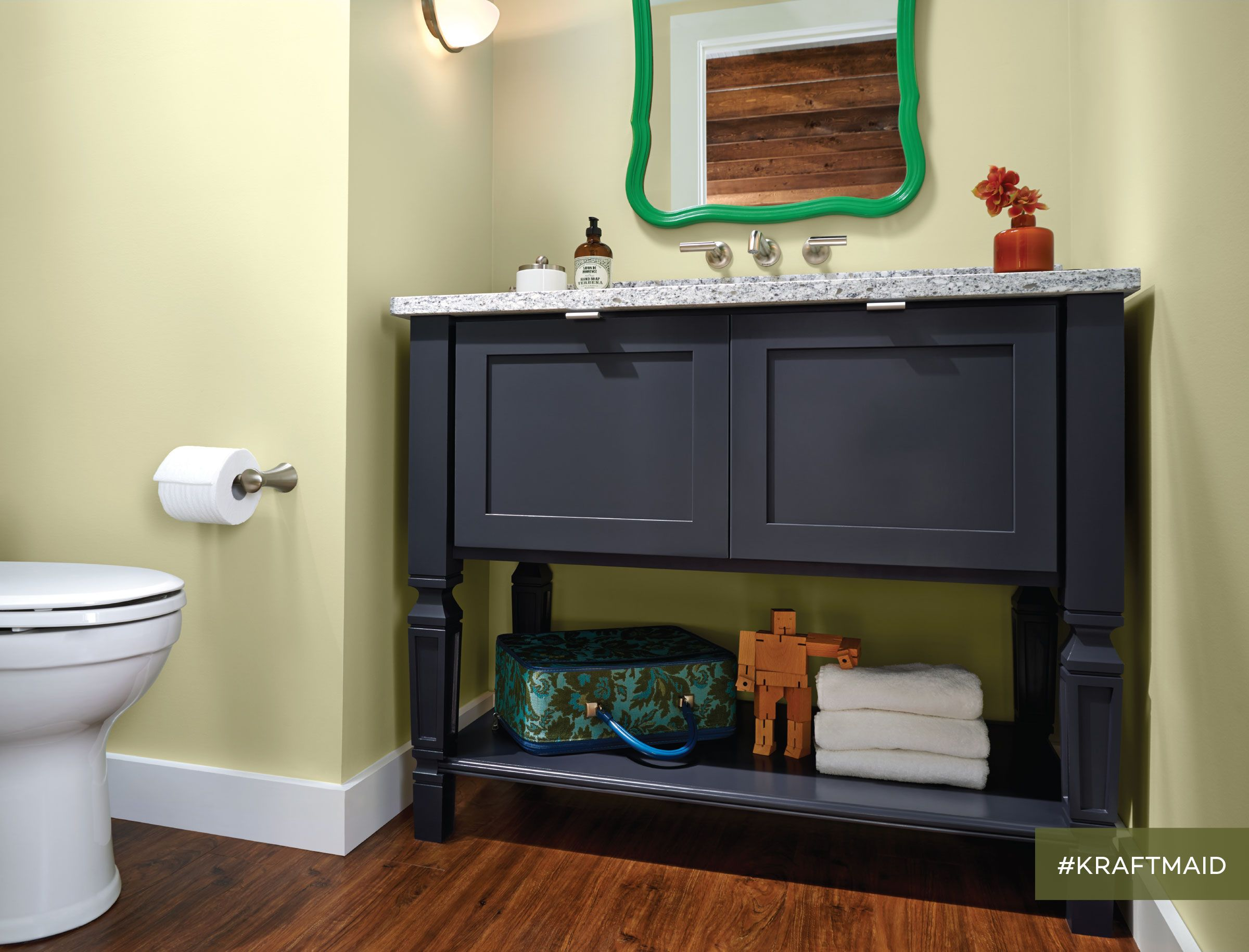 KraftMaid s console vanity for the bathroom looks like furniture and