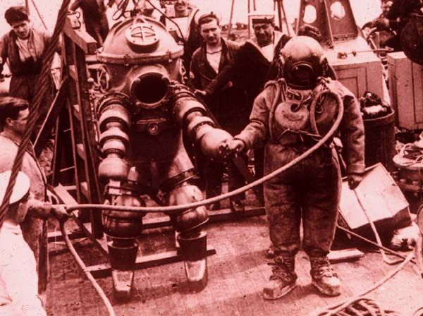 An early 1 atmosphere diving suit, c.a. 1935 Being readied for a dive on the wreck of the Lusitania.  This is the predecessor to the modern Newt diving suit.