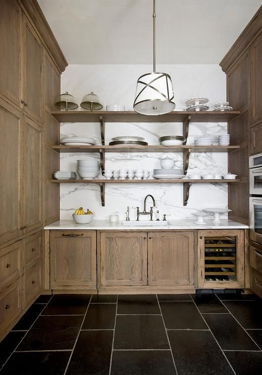 Rustic Walk In Pantry With Marble Slab Backsplash Display A Set Of Stacked Shelves Over