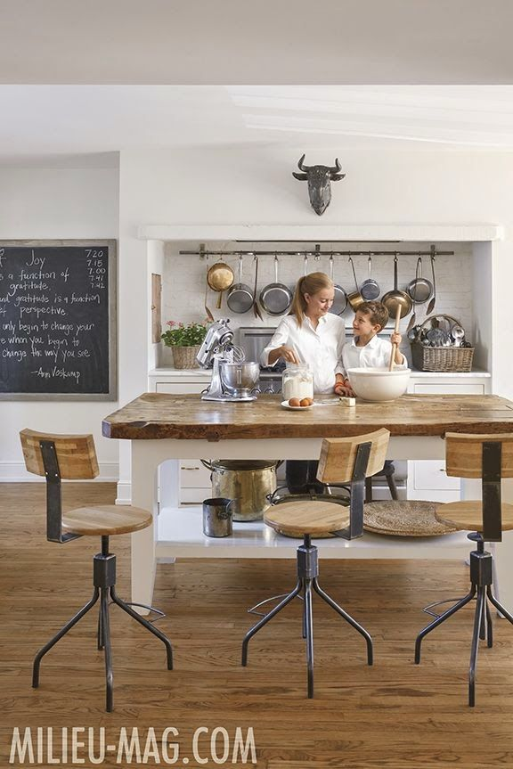 European farmhouse style kitchen/Shannon Bowers/Milieu Magazine/kitchen/bar stools/wood top island/pot rack/oxen head/chalkboard/wood floor/antiques