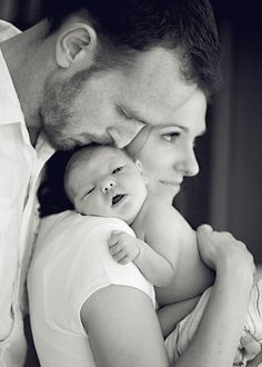 Parents posing with baby