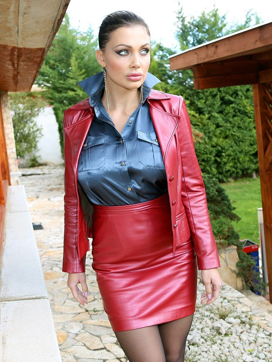 Busty Lady In A Shimmering Satin Blouse And Red Pvc Outfit