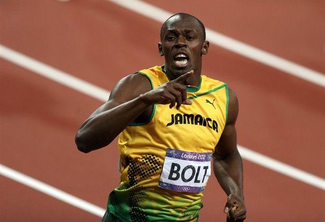Usain Bolt of Jamaica celebrates after winning gold ...
