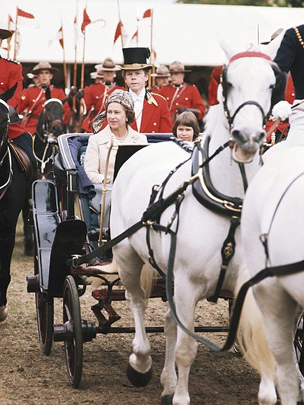 The Queen and the Royal Windsor Horse Show: A Love Story | 1974 | A regal arrival: The Queen heads into the show by horse and carriage with her niece, Lady Sarah Armstrong-Jones, in tow.
