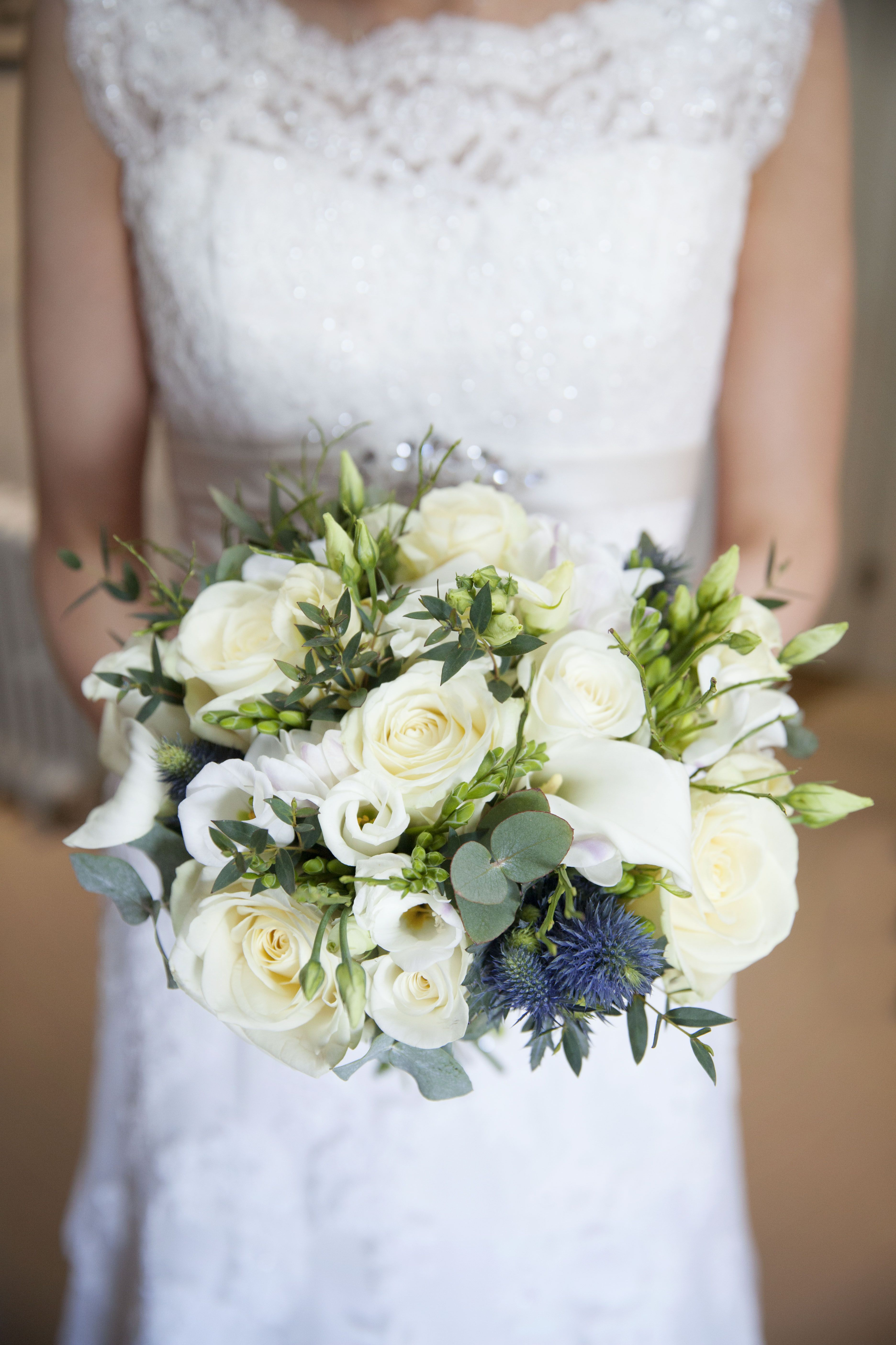 hand tied bouquet of white calla lilies, roses and